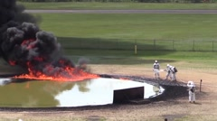 Airport firefighters extinguishing training fire Stock Footage