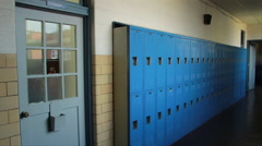 Old High School Hallway Lockers Painted Blue and Brown Stock Footage