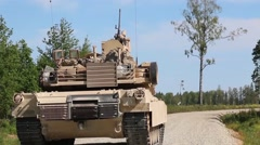 M1A2 and BFV Tanks live fire on the range Stock Footage