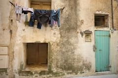 Laundry drying on a washing line outside a house in Bonifacio on Corsica. Stock Photos