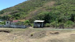 St. Kitts 026 train along a Caribbean village at mountainside Stock Footage