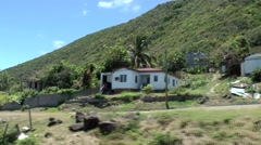 St. Kitts 027 occasional houses at mountain road seen from train in motion - stock footage