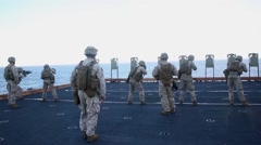 Marines and sailors deckshoot Aboard USS Bonhomme Richard - stock footage