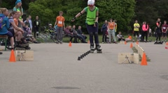 Rollerskater girl in one foot slalom competition. 4K Stock Footage