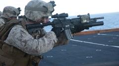 Marines and sailors deckshoot Aboard USS Bonhomme Richard Stock Footage