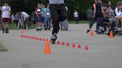 Plastic roller skater man in one wheel slalom competition. 4K Stock Footage