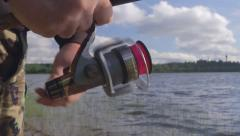 angler fishing spinning reel - stock footage