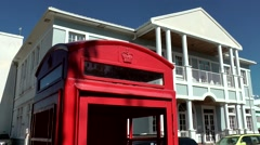 St. Kitts 052 Basseterre downtown red British phone box, administration building Stock Footage