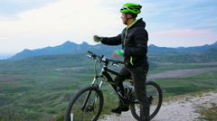 Mountain Biker Meeting Small Airplane At Hilly Terrain Stock Footage