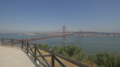 View of 25th of April Bridge and Lisbon from Christ the King statue, Lisbon Stock Footage