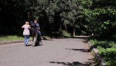 KIEV, Ukraine – JULY 18, 2015: Family Walking Along Park Road Stock Footage
