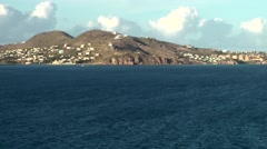 St. Kitts 065 set sail with cruise ship; settlements at mountain side Stock Footage