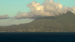 St. Kitts 066 vessel passes Nevis volcanic mountain with amazing clouds Stock Footage