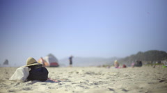 Travel bag sitting on beach Stock Footage