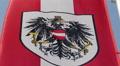Austrian flag with national emblem, symbol waving slowly in wind HD Footage