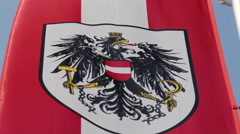 Austrian flag with national emblem, symbol waving slowly in wind Stock Footage