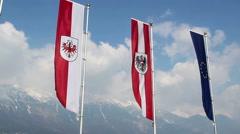 EU, Austrian, Tyrol flags wave, popular European mountain resort Stock Footage