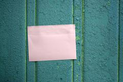 Memo stick on wooden fence Stock Photos
