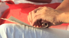 Young Couple Wrapping Romantic Letters on Tubes Stock Footage