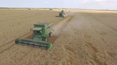 Aerial of Combine Harvesters Harvesting Wheat Stock Footage