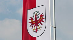 Flag with Tyrol coat of arms, popular Austrian tourism center Stock Footage