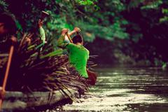 Canoes in the Yasuni national park Ecuador, carring straw plant - stock photo
