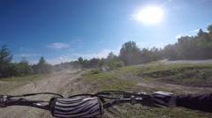 Mx rider jumps beside rider cam Stock Footage