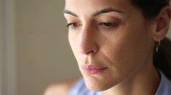 A close-up of a woman thinking - stock footage