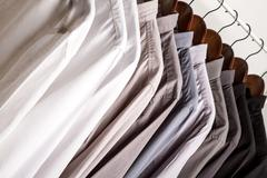 Several shirts on a hanger. Stock Photos