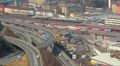 Time lapse, aerial view of intensive traffic on flyover, railway HD Footage