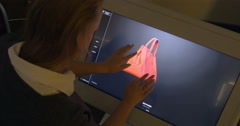 Woman Viewing 3D Model of a Bag on Big Touch Screen Stock Footage