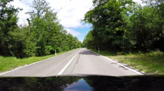 Bonnet-view footage of a car going down the winding road - stock footage