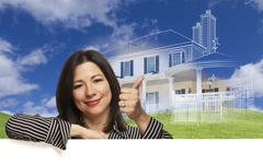 Thumbs Up Hispanic Woman with Ghosted House Drawing Behind - stock illustration