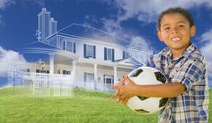 Mixed Race Boy Holding Ball with Ghosted House Drawing Behind Stock Illustration
