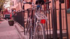 Bicycle Agaisnt Iron Fence in the City Stock Footage
