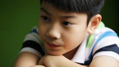 Sadness asian kid sit and depressed ,Tilt up camera Stock Footage