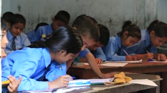 Indian girls and boys in a local school during the lesson , India - stock footage