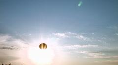 Air balloon cross the sun Stock Footage