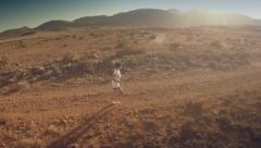 Lateral aerial view of a runner at desert. Spain. 4K Stock Footage