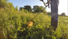Mowing grass trimmers Farmland Stock Footage