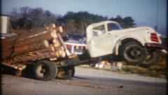 2349 - overloaded with logs, truck tips over - vintage film home movie Stock Footage