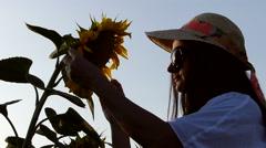 Woman enjoying on sunflower field on summer day. Stock Footage