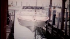 2353 - family launching the boat, then fishing trip - vintage film home movie Stock Footage