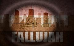 sniper scope aimed at the abstract silhouette of the city with text Fallujah - stock illustration