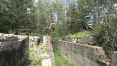 Big Running Jump Across Abandoned Building Ruins Stock Footage