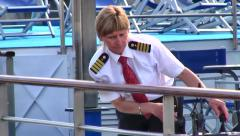 Only woman cruise ship captain in France docking ship, Lyon, France - stock footage