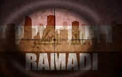 sniper scope aimed at the abstract silhouette of the city with text Ramadi at - stock illustration