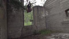 Parkour Flips Through Grunge Abandoned Building Ruins Stock Footage
