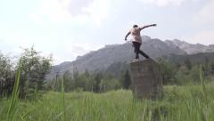 Huge Slow Motion Backflip off of Ruins in Wilderness Stock Footage