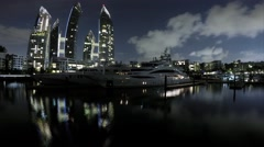 Nigh Timelapse of Kappel Bay with Mega Yachts and Luxury Condominium - stock footage